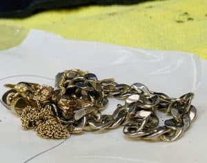 A small pile of broken and discarded jewellery.